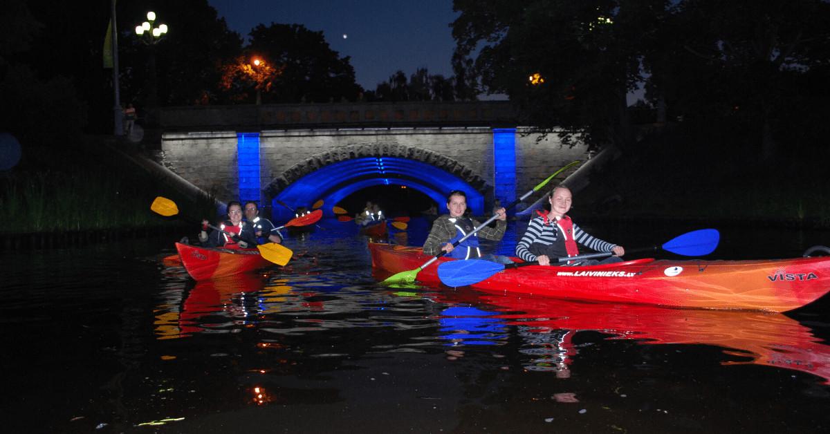 Riga city canal kayaking at night